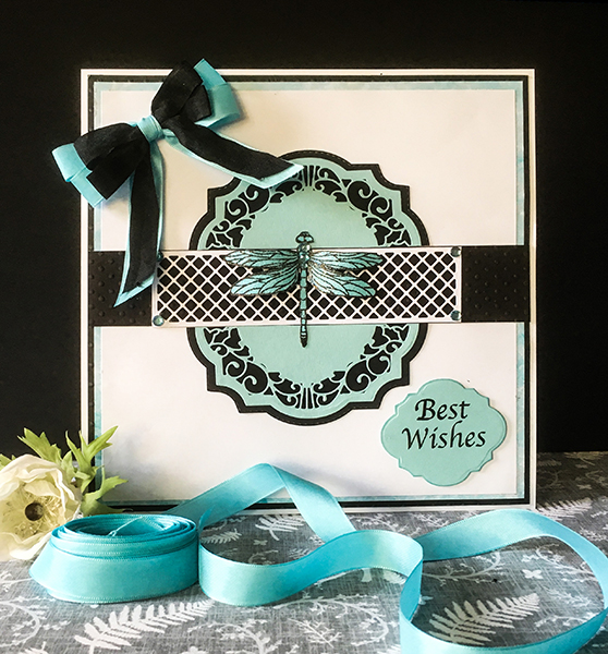 Black, white and teal dragonfliy layered card